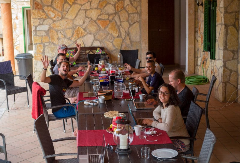 Group of people working together in a villa in Mallorca